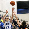 Jeff Krage — For the Kane County Chronicle<br /> Geneva's Mike Trimble fires a shot over St. Charles East's Dom Adduci during Friday's game in Geneva.<br /> Geneva 1/25/13