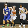 Geneva's Sami Pawlak (31) fights for a loose ball against Streamwood's Kiana Jeremiah (24) during the first half of play at Streamwood HighSchool in Streamwood, IL on Friday, January 25, 2013 (Sean King for The Kane County Chronicle)