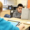 Alice Gustafson Elementary School fifth grader Jordan Ramirez uses an iPad for a project Wednesday.