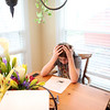 Tanner Saunders, 15, works on a biology test during a tutoring session in the kitchen of his Campton Hills home. Tanner suffers from complex regional pain syndrome.