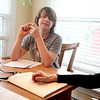 Tanner Saunders, 15, works with a tutor in the kitchen of his Campton Hills home. Tanner suffers from complex regional pain syndrome.