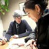 Literacy Volunteers Fox Valley volunteer Sue Styer of Geneva (left) helps St. Charles resident Reina Macîas with her English skills at the St. Charles Public Library. LVFV has expanded to include SCORE mentors to help with small businesses.