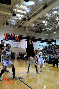 Hinsdale South senior guard Jerry Stoltz puts up a floater during a game at Addison Trail on Friday, Jan. 11, 2013. Matthew Piechalak— mpiechalak@shawmedia.com.