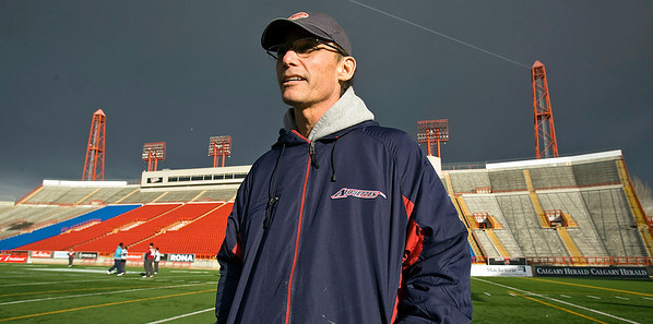Montreal Alouettes coach Marc Trestman stands on the field at McMahon Stadium during a 2009 practice in Calgary, Alberta. (AP Photo/The Canadian Press, Paul Chiasson, File)