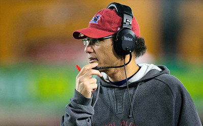 Montreal Alouettes head coach Marc Trestman talks into his headset during the final minutes of a Canadian Football League game against the Hamilton Tiger-Cats in Hamilton, Ontario Sept. 29, 2012. The Bears hired Trestman on Wednesday, Jan. 16, 2013,  to replace the fired Lovie Smith, hoping he can get the most out of quarterback Jay Cutler and make Chicago a playoff team on a consistent basis. (AP Photo/The Canadian Press, Geoff Robins)