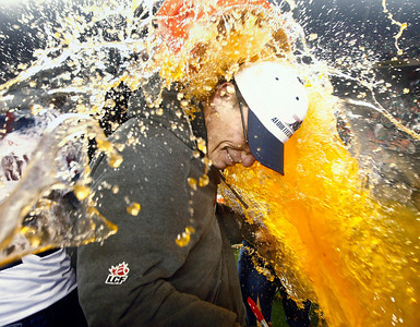 Montreal Alouettes head coach Marc Trestman is doused with Gatorade after their 2010 Grey Cup win over the Saskatchewan Roughriders, in Edmonton, Alberta.  (AP Photo/The Canadian Press, Nathan Denette)