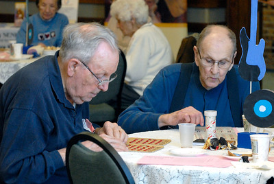 """Bill Bowers, right, and Ray Walters, both of Downers Grove, play bingo during a """"Blue Suede Bingo"""" event, sponsored by Westmont-based Seniors Helping Seniors, at the Lincoln Center, 935 Maple Ave. in Downers Grove on Friday, Jan. 18, 2013. Matthew Piechalak— mpiechalak@shawmedia.com."""