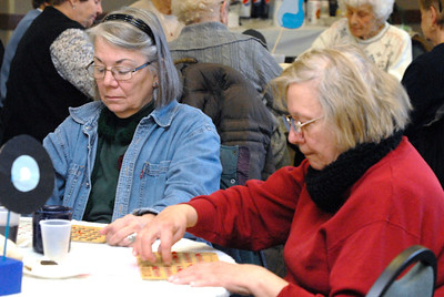 "Gwynne Tarr, left, and Virginia ViGiacomo, both of Downers Grove, play bingo during a ""Blue Suede Bingo"" event, sponsored by Westmont-based Seniors Helping Seniors, at the Lincoln Center, 935 Maple Ave. in Downers Grove on Friday, Jan. 18, 2013. Matthew Piechalak— mpiechalak@shawmedia.com."