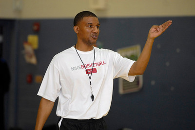 Keith Boyd, head coach of the fifth and sixth grade girls basketball team associated with the Bolingbrook Panther Sports Club, goes through a drill with players during a practice on Thursday, Jan. 17, 2013. Matthew Piechalak— mpiechalak@shawmedia.com.
