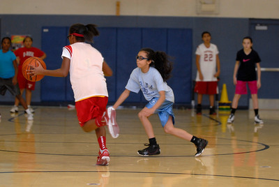 Twelve-year-old Marisa Manning, right, plays defense on teammate Jayden Marable, 10, during a practice for the fifth and sixth grade girls basketball team associated with the Bolingbrook Panther Sports Club on Thursday, Jan. 17, 2013. Matthew Piechalak— mpiechalak@shawmedia.com.