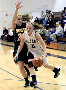 Sarah Nader - snader@shawmedia.com Cary-Grove's Katie Barker (right) is guarded by Crystal Lake South's Sara Mickow while she brings the ball down court during the fourth quarter of Friday's game in Cary on January 18, 2013. Cary-Grove won, 48-36.