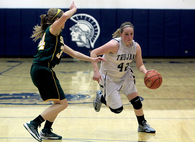 Sarah Nader - snader@shawmedia.com Cary-Grove's Olivia Jakubicek brings the ball down court during the third quarter of Friday's game against Crystal Lake South in Cary on January 18, 2013. Cary-Grove won, 48-36.