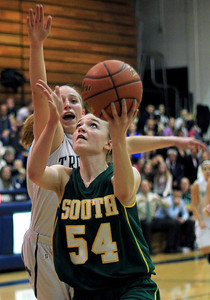 Sarah Nader - snader@shawmedia.com Crystal Lake South's Chanel Fanter eyes the basket during the first quarter of Friday's game against Cary-Grove in Cary on January 18, 2013. Cary-Grove won, 48-36.