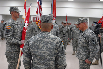 Maj. Gen. David Conboy, left, holds the command flag after receiving it from his predecessor, Brig. Gen. Charles Martin, right, during a change of command ceremony for the 416th Theater Engineer Command at the Parkhurst Reserve Center in Darien on Saturday, Jan. 5, 2013. Matthew Piechalak— mpiechalak@shawmedia.com.