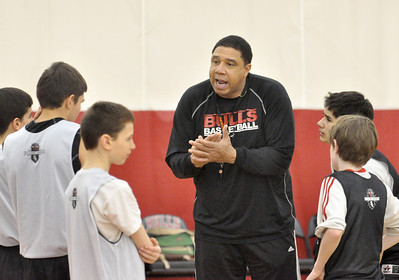 Daryl Thomas, of Bolingbrook, coaches eighth graders at the Bull/Sox Academy in Lisle on Thursday, Jan. 24, 2013.  Bill Ackerman — backerman@shawmedia.com