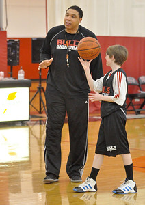 Daryl Thomas, of Bolingbrook, coaches eighth graders, including Liam Costello, 13, of Hinsdale, at the Bull/Sox Academy in Lisle on Thursday, Jan. 24, 2013.  Bill Ackerman — backerman@shawmedia.com