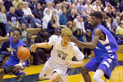 Downers Grove South forward Kevin Hall has the ball stripped from behind from Proviso East defenders.  Proviso won 80-55. Colin McAuliffe – For Suburban Life Media