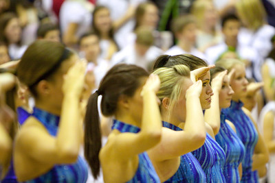 Downers Grove South dancers salute the flag during the national anthem prior to the Mustangs vs. Proviso East Pirates. Colin McAuliffe – For Suburban Life Media