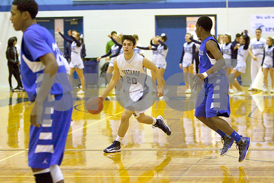 Downers Grove South Mustangs guard Danny Spinuzza drives past Proviso East defenders during the Pirates 80-55 victory. Colin McAuliffe – For Suburban Life Media