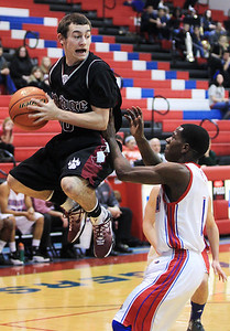 Sarah Nader - snader@shawmedia.com Prairie Ridge's Jay DeLage (left) shoots over Dundee-Crown's James-Hill Beasly during the first quarter of Tuesday's game in Carpentersville on January 8, 2013. Dundee-Crown won, 52-48.