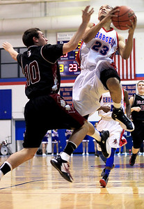 Sarah Nader - snader@shawmedia.com Dundee-Crown's Brandon Rodriguez (right) shoots over Prairie Ridge's Jay DeLage during the third quarter of Tuesday's game in Carpentersville on January 8, 2013. Dundee-Crown won, 52-48.