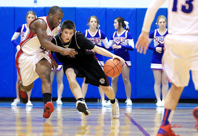Sarah Nader - snader@shawmedia.com Dundee- Crown's Cordero Parson (left) guards Prairie Ridge's Michael Bradshaw during the second quarter of Tuesday's game in Carpentersville on January 8, 2013. Dundee-Crown won, 52-48.
