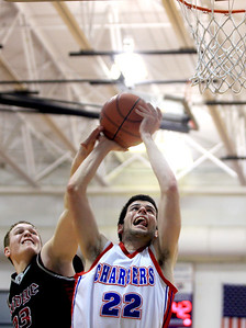 Sarah Nader - snader@shawmedia.com Prairie Ridge's Josh Behning (left) tries to block a shot by Dundee-Crown's Trent Muscat during the fourth quarter of Tuesday's game in Carpentersville on January 8, 2013. Dundee-Crown won, 52-48.
