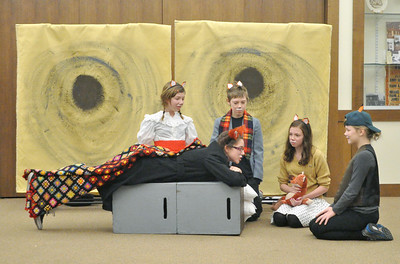 "Mr. Fox (Arianna Ozanich) lays down after a farmer shot off his tail. His wife (from left) and children, Caroline Viravec, Danny Donovan, Anna Conneely, and Samantha Land, sympathize with him. The touring company of the Children's Theatre of Western Springs performs ""The Fantastic Mr. Fox"" at the North Riverside Public Library on Saturday, Jan. 26, 2013. Bill Ackerman — backerman@shawmedia.com"