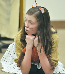 "One of the Foxes' children, played by Anna Conneely, wonders how the family will survive after the Fox family is trapped by angry farmers. The touring company of the Children's Theatre of Western Springs performs ""The Fantastic Mr. Fox"" at the North Riverside Public Library on Saturday, Jan. 26, 2013. Bill Ackerman — backerman@shawmedia.com"