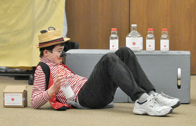 "Rat, played by Nick Wolf, enjoys a farmer's supply of cider as the touring company of the Children's Theatre of Western Springs performs ""The Fantastic Mr. Fox"" at the North Riverside Public Library on Saturday, Jan. 26, 2013. Bill Ackerman — backerman@shawmedia.com"