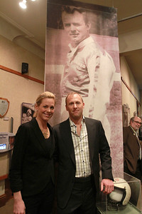 Sarah Minor — sminor@shawmedia.com Amanda Gardstrom and Chris Lorenzen stand in front of a poster of their father Fren Lorenzen, NASCAR driver and Elmhurst native, at the opening of Elmhurst Historical Museum's exhibit on Thursday, Jan. 31.