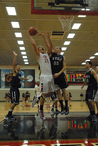 Glenbard East senior Greg Ludwig goes strong to the basket during a game against West Chicago on Saturday, Jan. 5, 2013. Matthew Piechalak— mpiechalak@shawmedia.com.