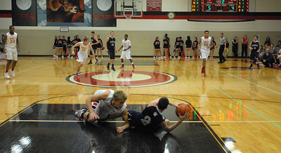 West Chicago senior Jimmy Rizzo (No. 2) grabs a loose ball on the floor during a game at Glenbard East on Saturday, Jan. 5, 2013. Matthew Piechalak— mpiechalak@shawmedia.com.