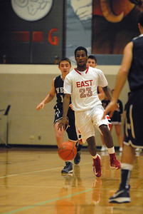 Glenbard East junior JaRon Hall brings the ball across half-court during a game against West Chicago on Saturday, Jan. 5, 2013. Matthew Piechalak— mpiechalak@shawmedia.com.