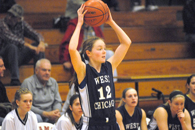 West Chicago's Mae-Elizabeth Gimre holds the ball over her head while looking to pass during a game at Glenbard East on Saturday, Jan. 5, 2013. Matthew Piechalak— mpiechalak@shawmedia.com.