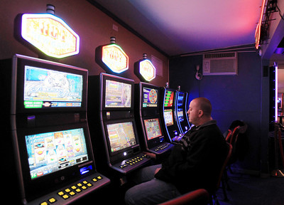 Sarah Nader - snader@shawmedia.com David Balk of Lakemoor gambles at one of the five video gaming machines at The Gambler in McHenry on Friday, January 4, 2013. It is coming up on three months since video gaming was clicked on at a few establishments in McHenry County.  © Northwest Herald