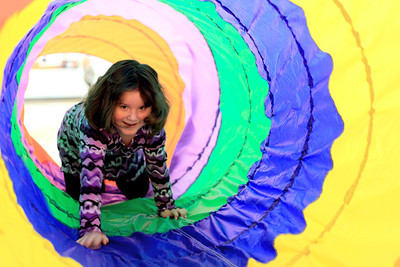 Sarah Nader - snader@shawmedia.com Amelia Hernandez, 4, of Harvard crawls through a colorful tube while attending Kids' Bash 2012 at Crosby Elementary School in Harvard on Monday, December 31, 2012. Children enjoyed face painting, games, crafts, balloons and music and celebrated the new year by counting down to noon.   © Northwest Herald