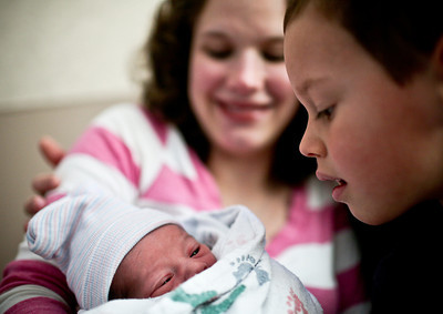 Josh Peckler - Jpeckler@shawmedia.com Daniel Camache of Huntley looks down at his new baby brother Christopher while being held by their mother Daniela at Centegra Hospital in Woodstock Tuesday, January 1, 2013. Christopher was the first baby born in Mchenry County in 2013 when he was born at 12:10 AM.   © Northwest Herald