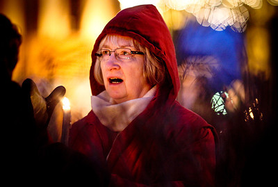 Josh Peckler - jpeckler@shawmedia.com Phyllis Sylvester of Woodstock holds a candle during a candlelight vigil to honor those lost during the shooting at Sandy Hook Elementary School. The event organized by the McHenry County Regional Superintendent of Schools Leslie Schermerhorn was held a the Woodstock Square Thursday, December 27, 2012.  © Northwest Herald