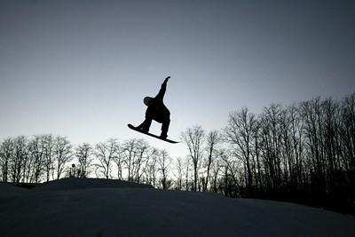 Monica Maschak - mmaschak@shawmedia.com A snowboarder launches into the air from a jump at the Raging Buffalo Snowboard and Ski Park in Algonquin on Wednesday, January 2, 2013.  © Northwest Herald