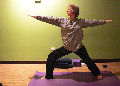 Monica Maschak - mmaschak@shawmedia.com June McHugh, a student in the Level 1 yoga class, does a Warrior 2 pose in the class at Yoga Seva in Crystal Lake. McHugh says she takes the class to better herself.