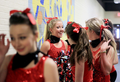 Sarah Nader - snader@shawmedia.com Jori Brockway (center), 16, of Johnsburg waits in the hall with the Johnsburg High School Dance Team before Thursday's pep rally for the Dance Team at the school on January 24, 2013. The Dance Team finished third at the Grayslake North Sectional will advance to the State Championship in Bloomington.