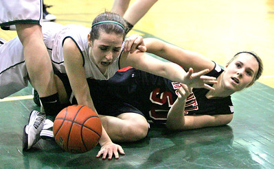 Monica Maschak - mmaschak@shawmedia.com Crystal Lake South's Stephanie Oros and Huntley's Ali Andrews take a tumble after fighting for control of the ball in the fourth quarter of Wednesday's close game. The Lady Red Raiders beat the Lady Gators 54-52 in double overtime.