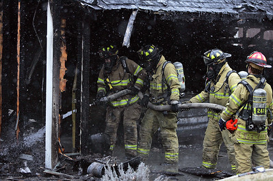 Monica Maschak - mmaschak@shawmedia.com Firefighters douse the remains of a Wauconda garage that caught on fire at 26703 N. Main Street shortly before 1 p.m. on Wednesday, January 23, 2013. Fifteen fire departments responded. The cause of the fire is still under investigation. There were no reported injuries.