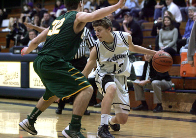 Monica Maschak - mmaschak@shawmedia.com Cary-Grove's Jason Gregoire peers over the a Crystal Lake South guard in a game against the Gators on Tuesday, January 29, 2013.  The Gators won 67-54.