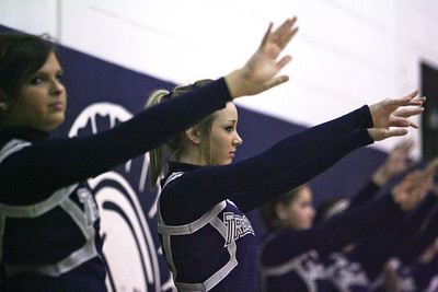 Monica Maschak - mmaschak@shawmedia.com Cary-Grove Varisty Cheerleading Captain Sarah Mishall leads the squad in sending good vibes to the boys basketball team during a match at the school.  As sectional champions, the Cary-Grove cheerleaders will advance to the IHSA State Final Championship on Friday, February 1, 2013.