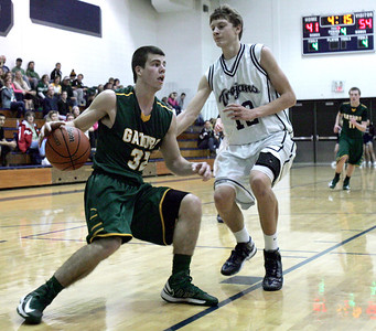 Monica Maschak - mmaschak@shawmedia.com Crystal Lake South's Nick Geske dribbles in toward the hoop in a game at Cary-Grove High School on Tuesday, January 29, 2013.  The Gators won 67-54.