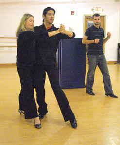 On Saturday, Jan. 12, 2013, Eric Ott (right), of Geneva, watches as Michael Saelee demonstrates a step with Elizabeth Ott as they rehearse in the State Street Dance Studio for the Dancing with Geneva Stars event. Michael and AuBrey Saelee are coaching the Otts and two other couples for the event. Bill Ackerman — backerman@shawmedia.com
