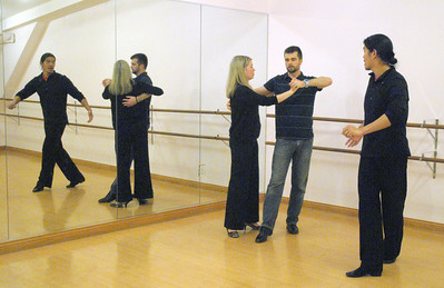 On Saturday, Jan. 12, 2013, Elizabeth and Eric Ott, of Geneva, rehearse in the State Street Dance Studio for the Dancing with Geneva Stars event, coached by Michael (right) and AuBrey Saelee. Bill Ackerman — backerman@shawmedia.com