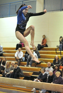 Geneva's Ashley Puff scores 9.35 on the beam on Monday, Jan. 14, 2013 in a home gymnastics meet with Neuqua Valley and Yorkville. Bill Ackerman — backerman@shawmedia.com
